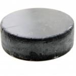 Black old hockey puck